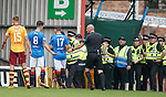 Ryan Jack passes a missile to ref Bobby Madden