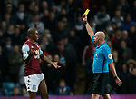 Wesley of Aston Villa is shown the yellow card by referee Lee Mason during the Premier League match at Villa Park, Birmingham. Picture date: 25th November 2019. Picture credit should read: Darren Staples/Sportimage