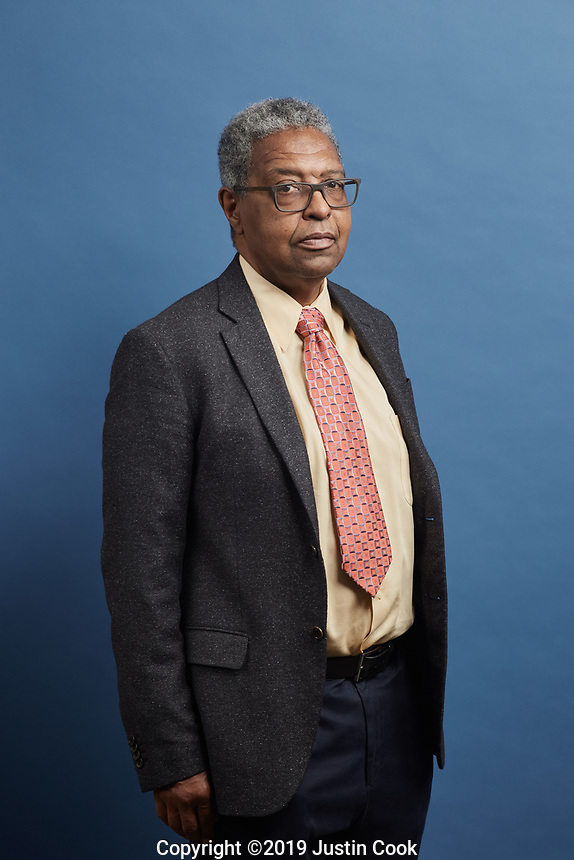 """Portraits of Dr. William A. Darity, Jr., Samuel DuBois Cook Professor of Public Policy, Professor in the Sanford School of Public Policy, Professor of African and African American Studies, Professor of Economics at the Samuel DuBois Cook Center for Social Equity at Duke University  in Durham, North Carolina, Monday, June 10, 2019  (Justin Cook for The Wall Street Journal)<br /> <br /> STRATECON<br /> <br /> For decades, William A. Darity Jr. and Darrick Hamilton toiled in obscurity, two African-American economists touting guaranteed jobs and reparations for slave descendants, blasting mainstream economists for failing to address racial disparities. - - - - - - Now the two scholars find themselves in the limelight of the 2020 presidential campaign. - - - - - - On stage at a March conference for liberal activists, Mr. Hamilton gets a hug from New Jersey Sen. Cory Booker, who tells him: """"You've really laid the foundation for a lot of things that we're doing."""" Backstage, California Sen. Kamala Harris chats with Mr. Hamilton, an Ohio State University professor who helped her shape a middle-class tax cut proposal. Former Texas Rep. Beto O'Rourke, asked in a television interview how to frame the party's new platform, replies: """"There's an extraordinary economist named Darrick Hamilton who talks about a more conscious capitalism."""" - - - - - - For Mr. Hamilton, and for his Duke University mentor, Mr. Darity, the frequent engagement with Democratic hopefuls marks a breakthrough. """"I'm becoming mainstream,"""" says Mr. Hamilton, who has also advised Vermont Sen. Bernie Sanders on job guarantees and Massachusetts Sen. Elizabeth Warren on student debt relief. - - - - - - Many Democratic lawmakers and voters are moving left, creating an opening for big-government solutions to perceived free-market failures. They talk more explicitly about race, appealing to the party's minority-heavy base. Sweeping ideas – the grander the better -- are more fashionable than the """"incrementalism�"""