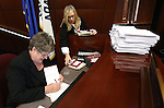 Nevada Assembly staffers Christie Peters and Debra Willams work on a major bill deadline day at the Nevada Legislature in Carson City, Nev., on Monday, March 18, 2013..Photo by Cathleen Allison