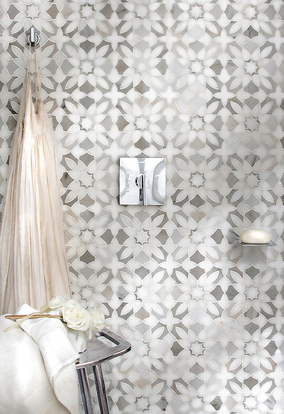 Valencia, a waterjet mosaic, shown in honed Afyon White and Angora, is part of the Miraflores Collection by Paul Schatz for New Ravenna.