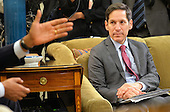 Dr. Thomas Frieden, Director of the Centers for Disease Control and Prevention listens as United States President Barack Obama addresses the media following a meeting with Obama's team coordinating the government's Ebola response, in the Oval Office at the White House in Washington, D.C. on October 16, 2014. <br /> Credit: Kevin Dietsch / Pool via CNP