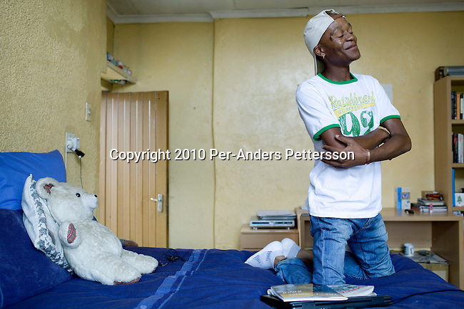 SOWETO, SOUTH AFRICA - JANUARY 15: Thami Nkosi, a 29-year old activist, sits on his bed in his room on January 15, 2010, in Soweto, South Africa. Thami is a gender justice activist and often counsels men how to use condoms and not to cheat or abuse women. He is part of the new young generation of black South African's who has got better education opportunities. Soweto is the largest township in South Africa, located about 10 kilometers southwest of downtown Johannesburg. The population is estimated to be around 2-3 million. (Photo by Per-Anders Pettersson/Getty Images)