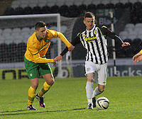 Mark Williams being held back by Connor McManus in the St Mirren v Celtic Scottish Professional Football League Under 20 match played at St Mirren Park, Paisley on 30.4.14.