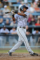 Kannapolis Intimidators center fielder Ruben Sierra Jr. #18 swings at a pitch during a game against the Asheville Tourists at McCormick Field on May 9, 2013 in Asheville, North Carolina. The Intimidators won the game 13-12. (Tony Farlow/Four Seam Images).