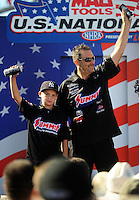 Sept. 6, 2010; Clermont, IN, USA; NHRA pro stock driver Greg Anderson (right) with son Cody Anderson during driver introductions prior to the U.S. Nationals at O'Reilly Raceway Park at Indianapolis. Mandatory Credit: Mark J. Rebilas-
