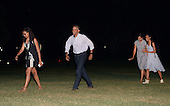 US President Barack Obama, First Lady Michelle Obama with daughters Malia and Sasha walk on the South Lawn of the White House to the Residence June 19, 2016 in Washington, DC. The First Family traveled to Yosemite National Park.<br /> Credit: Olivier Douliery / Pool via CNP