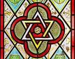 Star of David interlocking triangles Christian symbol nineteenth century decorative stained glass window, Easton Royal, Wiltshire