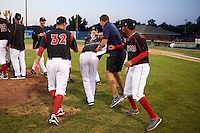 Batavia Muckdogs pitcher Gabriel Castellanos (center) is mobbed by teammates after a game against the Mahoning Valley Scrappers on June 24, 2015 at Dwyer Stadium in Batavia, New York.  Batavia defeated Mahoning Valley 1-0 as Castellanos went seven innings allowing no hits with twelve strikeouts combining with relief pitchers Brett Lilek and Steven Farnworth on the organizations first perfect game in team history. (Mike Janes/Four Seam Images)