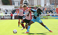Marcus Bean of Wycombe Wanderers battles for the ball with Christian Ribeiro of Exeter City during the Sky Bet League 2 match between Exeter City and Wycombe Wanderers at St James' Park, Exeter, England on 26 September 2015. Photo by Pinnacle Photo Agency.