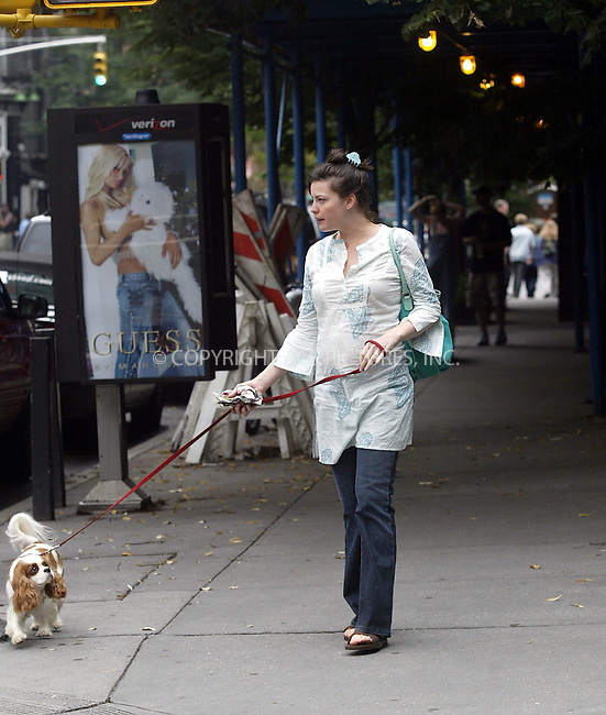 ** FEE MUST BE AGREED BEFORE USE **..Very Pregnant Liv Tyler walking her dog in West Village. Tyler was seen crossing the street on a red pedestrian traffic light. New York, August 15, 2004. Please byline: BRIAN FLANNERY--ACEPIXS.COM   ..  *** ***..Ace Pictures, Inc:  ..contact: Alecsey Boldeskul (646) 267-6913 ..Philip Vaughan (646) 769-0430..e-mail: info@acepixs.com