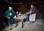Audelina Vasquez Lopez, a Maya Mam woman, feeds breakfast to her children in her home in Tuixcajchis, a small village in Comitancillo, Guatemala.