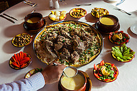 Mansaf ( lamb cooked in a sauce of fermented dried yogurt and served with rice). The national dish of Jordan. Al Quantarah Restaurant, Petra (Wadi Musa), Jordan.