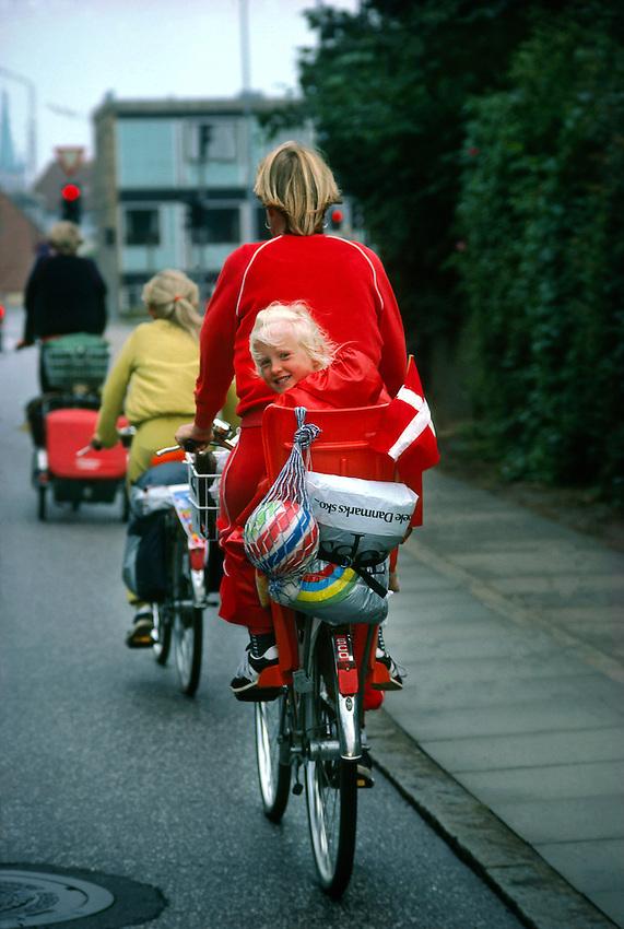Danish family riding bicycles, Frederikshavn, Jutland, Denmark