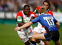Photo: Richard Lane/Richard Lane Photography. Bath Rugby v Biarritz Olympique. Heineken Cup. 10/10/2010. Biarraiz' Takudzwa Ngwenya is tackled by Bath's Nick Abendanon.
