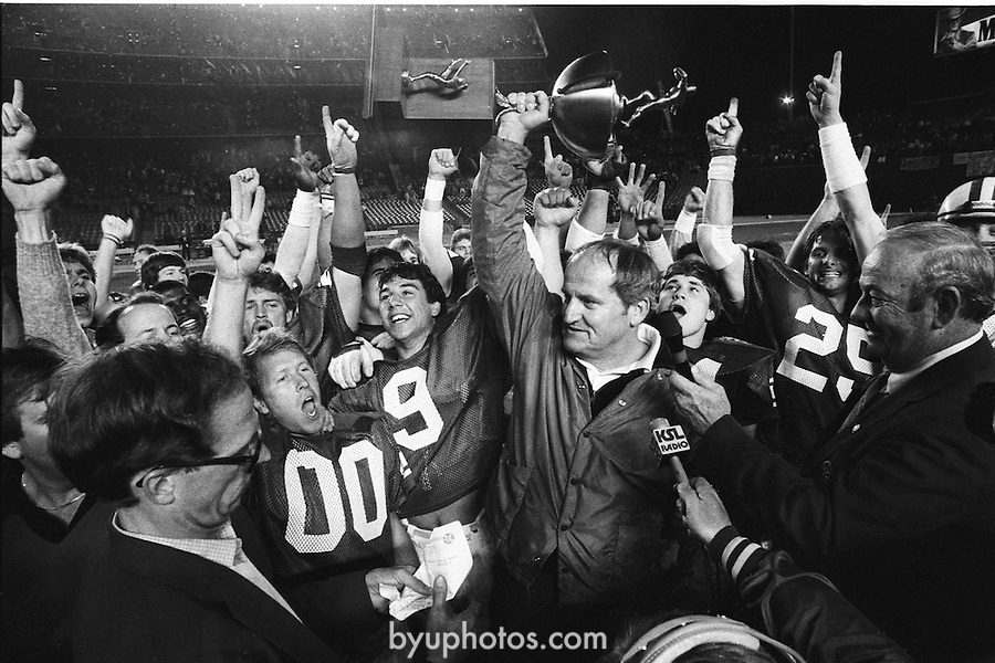 FTB 611 DD 43A Holiday MO<br /> <br /> Football Holiday Bowl. Coach LaVell Edwards with trophy. 00. 9 Rob Ledenko. 25 Bobby Salazar. KSL News Radio.<br /> <br /> Dec 23, 1983<br /> <br /> Box Number: 6371<br /> <br /> Photo by: Mark Philbrick/BYU<br /> <br /> Copyright BYU PHOTO 2008<br /> All Rights Reserved<br /> 801-422-7322<br /> photo@byu.edu