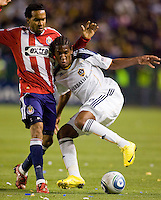LA Galaxy midfielder Alex Cazumba attempts to move around Chivas USA forward Maykel Galindo. The LA Galaxy defeated Chivas USA 2-0 during the Super Clasico at Home Depot Center stadium in Carson, California Thursday evening April 1, 2010.  .