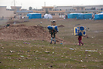 ARBAT, IRAQ: Syrian children carry mattresses through the Arbat refugee camp...45 families who have fled the violence in Syria are currently living in the Arbat refugee camp 19km outside the Iraqi city of Sulaimaniyah...Photo by Zmnako Ismael/Metrography