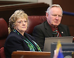 Nevada Sens. Joyce Woodhouse, D-Henderson, and  Don Gustavson, R-Sparks, work on the Senate floor at the Legislative Building in Carson City, Nev., on Thursday, April 18, 2013. .Photo by Cathleen Allison