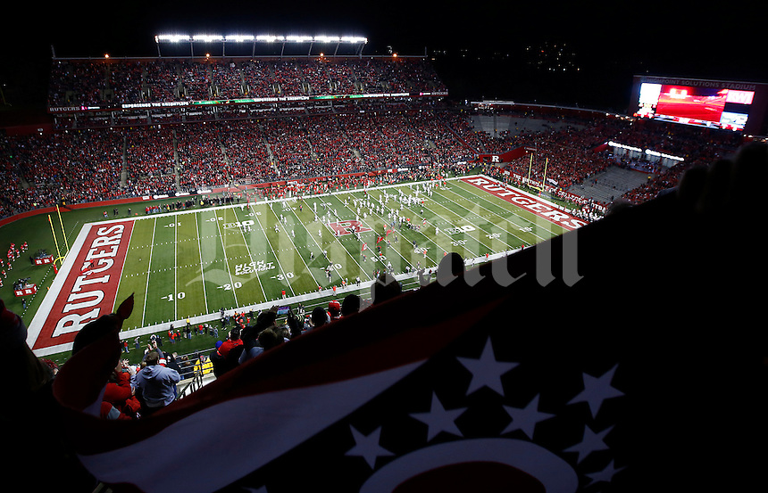The Ohio State Buckeyes run onto the field as fans hold up an Ohio flag before the college football game between the Rutgers Scarlet Knights and the Ohio State Buckeyes at High Point Solutions Stadium in Piscataway, NJ, Saturday night, October 24, 2015. As of half time the Ohio State Buckeyes led the Rutgers Scarlet Knights 21 - 0.(The Columbus Dispatch / Eamon Queeney)