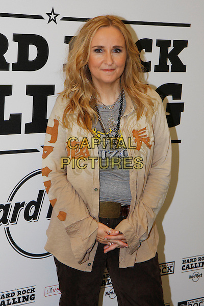 MELISSA ETHERIDGE .Backstage at Hyde Park Calling - Day 2, London, England, UK, 26th June 2010..music gig  festival concert half length beige shirt country jacket brown  grey gray t-shirt necklaces .CAP/MAR.©Martin Harris/Capital Pictures.