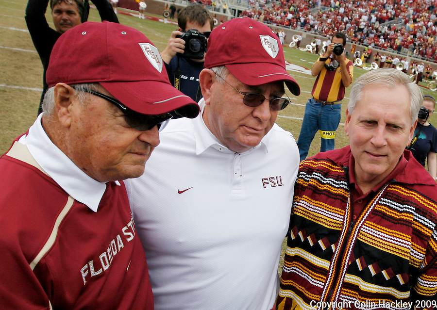 TALLAHASSEE, FL 11/21/09-FSU-MARY FB09 CH21-Florida State Head Coach Bobby Bowden, left, Defensive Coordinator Mickey Andrews and FSU President T.K. Wetherell pose for a photo during a ceremony to honor his service to FSU, Saturday at Doak Campbell Stadium in Tallahassee. .COLIN HACKLEY PHOTO