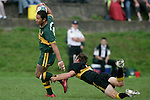 I. Tuifua steps out of the tackle of C. Radford. Counties Manukau Premier club rugby game between Bombay & Pukekohe played at Bombay on the 19th of May 2007. Pukekohe led 24 - 0 at halftime & went on to win 30 - 22.