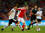 Aaron Ramsey of Wales bursts past Aleksandar Dragovic of Austria and Julian Baumgartlinger of Austria during the World Cup Qualifying Group D match at the Cardiff City Stadium, Cardiff. Picture date 2nd September 2017. Picture credit should read: Simon Bellis/Sportimage