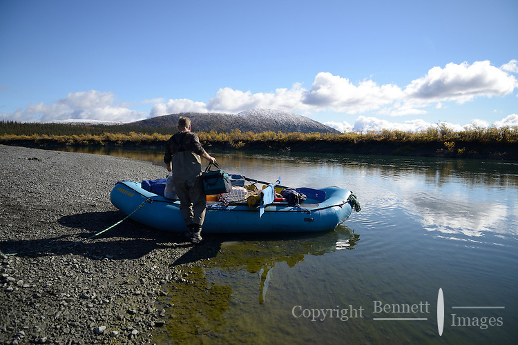 Eric Downey loads gear into his raft before heading down the Sheenjek River, which flows south from Alaska's Brooks Range into the Yukon River Flats, in the Arctic National Wildlife Refuge in late August. MR