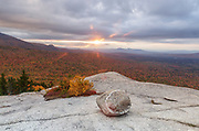 Sunset on a cloudy autumn day from Middle Sugarloaf Mountain in Bethlehem, New Hampshire.