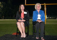 From left, Karen Maarse Fitzgerald accepts the Athletics Hall of Fame award for Maxine McMasters Mitchell '45 and Mary (Dennis) Carpenter '63 accepts for Roy Dennis '33. Alumni, family, staff and students at the Occidental College Athletics Hall of Fame event, part of Homecoming weekend, Oct. 24, 2014 on Patterson Field. (Photo by Marc Campos, Occidental College Photographer)