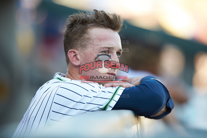 Drew Waters (11) of the Gwinnett Stripers watches from the dugout during the game against the Scranton/Wilkes-Barre RailRiders at BB&T BallPark on August 17, 2019 in Lawrenceville, Georgia. The Stripers defeated the RailRiders 8-7 in eleven innings. (Brian Westerholt/Four Seam Images)