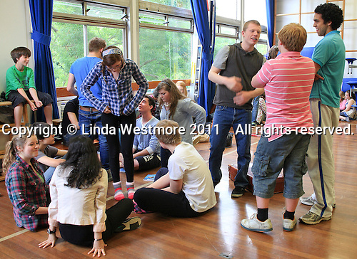 "Enjoying a break.  The Yvonne Arnaud Youth Theatre rehearsing ""The Lion, the Witch and the Wardrobe"", Guildford, Surrey."