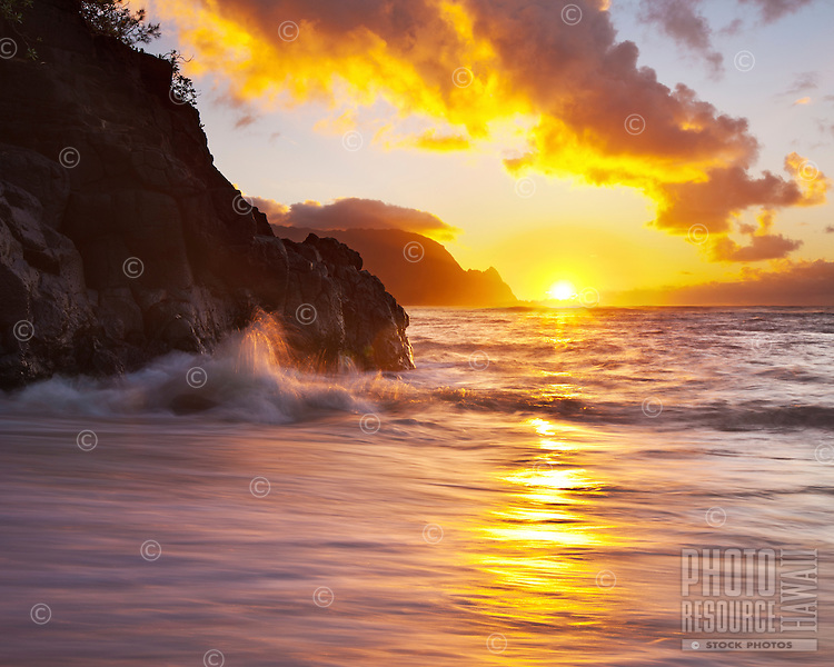 The sun disappears behind Mt. Makana (Bali Hai) as seen from Princeville, Kauai.