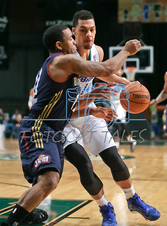 Reno Bighorns' Trent Lockett and Bakersfield Jam's Aaron Johnson compete in a D-League basketball game in Reno, Nev., on Tuesday, Jan. 14, 2014. The Bighorns won 93-85.<br /> Photo by Cathleen Allison