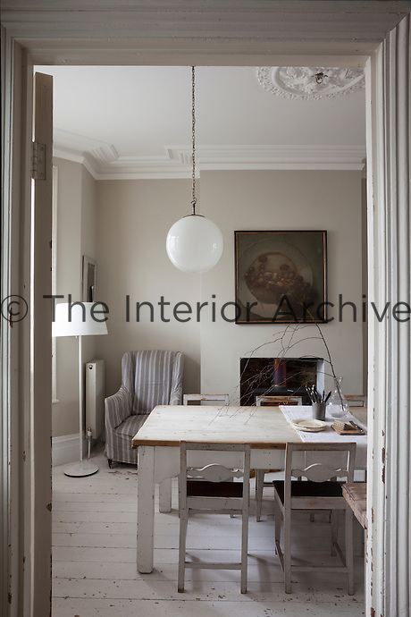 View into the simple and elegantly furnished dining room from the entrance hall