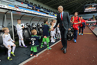 Arsenal manager Arsene Wenger is greeted by children mascots as he arrives prior to the Barclays Premier League match between Swansea City and Arsenal at the Liberty Stadium, Swansea on October 31st 2015