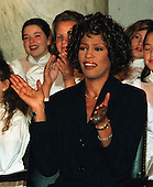 Whitney Houston applauds during  a Capitol Hill press confrence on October 1, 1997 in Washington, D.C. announcing her benefit concert at DAR Constitution Hall on October 5, 1997 for the Children's Defense Fund..Credit: Ron Sachs / CNP