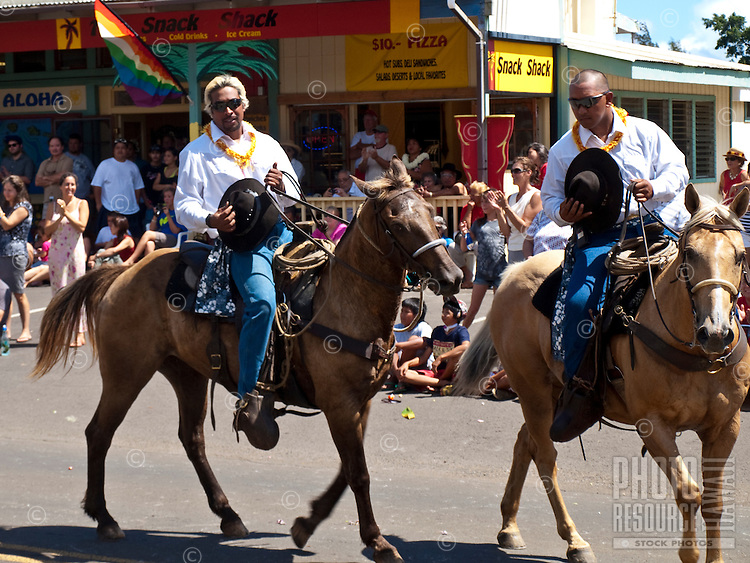 Pau riders on horseback in King Kamehameha Day Parade, North Kohala, Big Island of Hawaii, Kapa'au Town.