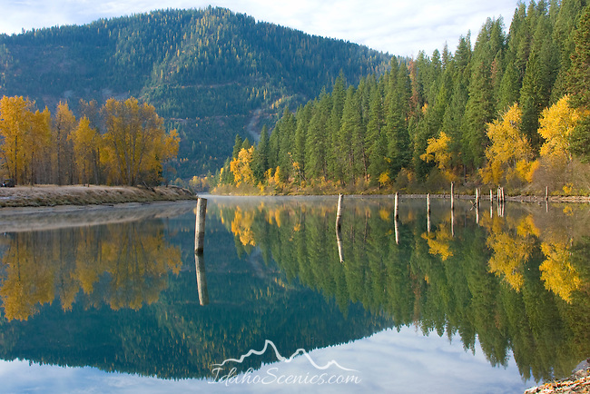 Idaho,Silver Valley, Rose Lake, Reflections in the water with rising mist and autumn colors.