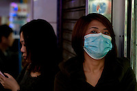 111229-N-DR144-475 HONG KONG (Dec. 29, 2011) Woman in surgical mask in Kowloon, Hong Kong. (U.S. Navy photo by Mass Communication Specialist 2nd Class James R. Evans/Released)