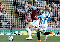 Burnley's James Tarkowski under pressure from Huddersfield Town's Alex Pritchard<br /> <br /> Photographer Rich Linley/CameraSport<br /> <br /> The Premier League - Burnley v Huddersfield Town - Saturday 6th October 2018 - Turf Moor - Burnley<br /> <br /> World Copyright &copy; 2018 CameraSport. All rights reserved. 43 Linden Ave. Countesthorpe. Leicester. England. LE8 5PG - Tel: +44 (0) 116 277 4147 - admin@camerasport.com - www.camerasport.com