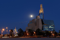 Canadian Museum for Human Rights (CMHR) with full moon rising and car traffic<br /> Winnipeg<br /> Manitoba<br /> Canada