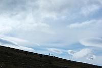 Silhouette of distant hikers against sky between Teusjaure and Vakkotavare, Kungsleden trail, Lapland, Sweden
