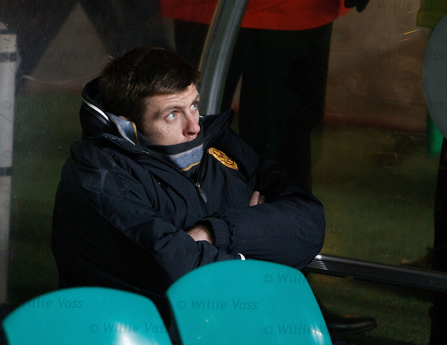 Suspended Motherwell player Steve Jennings sitting in the dugouts before the match starts