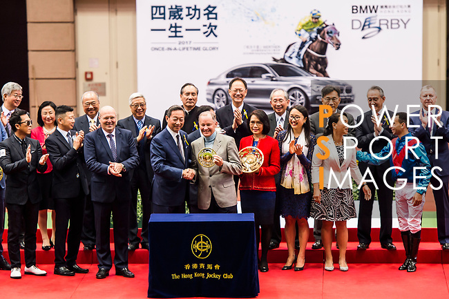 Horse trainer John Moore receives the prize after Rapper Dragon's winning 2017 BMW Hong Kong Derby Race at the Sha Tin Racecourse on 19 March 2017 in Hong Kong, China. Photo by Marcio Rodrigo Machado / Power Sport Images