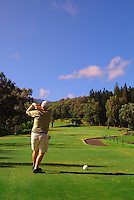 A man playing golf at Kapalua, Maui.