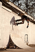 March 6, 2012. Carrboro, NC.. Randy Browne, wallride.. Skateboarding at Lumpside, a DIY concrete skate spot.
