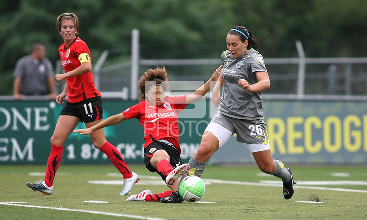 Philadelphia defender, Frida Magnusdottir (26) and Atlanta midfielder, Aya Miyama (18), battle for the ball in midfield.  After falling behind, 2-0 in the first half, the Philadelphia Independence bounced back to defeat the Atlanta Beat, 3-2 at John A Farrell Stadium in West Chester, Pennsylvania.