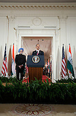Washington, DC - November 24, 2009 -- United States President Barack Obama speaks as Manmohan Singh, India's prime minister, watches during an arrival ceremony in the East Room of the White House in Washington, D.C., U.S., on Tuesday, November 24, 2009.  .Credit: Joshua Roberts - Pool via CNP